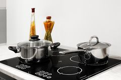 Utensils for cooking classes on electric stove in kitchen.  royalty free stock photography