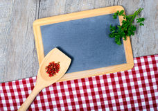 Utensils for cooking wood with a  blackboard Stock Photos