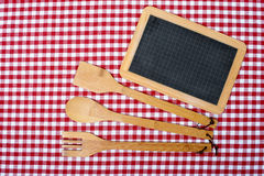 Utensils for cooking wood with a blackboard Stock Photography