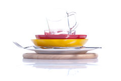 Utensils of different colors standing on a cutting board isolate Stock Photography