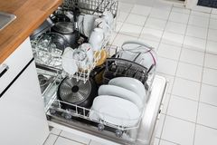 Utensils in dishwasher Royalty Free Stock Photo