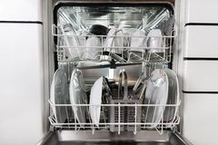 Utensils in dishwasher Royalty Free Stock Photography