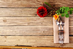 Utensils and Flowers on Table with Copy Space Stock Images