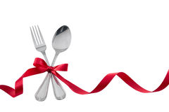 Utensils Fork Spoon with Red Ribbon isolated on white Royalty Free Stock Images