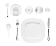 Utensils isolated on white background. White ceramics, glassware, fork, knife, spoon isolated on a white background Royalty Free Stock Images