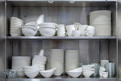Utensils in the kitchen cupboard Stock Photography