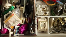 Utensils in kitchen drawer stock video footage