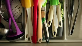 Utensils in kitchen drawer stock footage