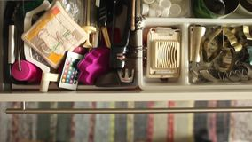 Utensils in kitchen drawer With rose stock footage