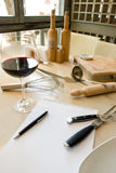 Utensils, notebook and wine Stock Photo