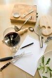 Utensils, notebook and wine Stock Image
