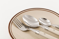 Utensils on a plate Stock Image