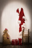 Utensils of santa clause - jacket, hat, boots, sack and sledge. Royalty Free Stock Images
