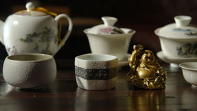 Utensils for the tea ceremony. Ceramic ware for the tea ceremony closeup stock video