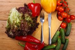 Utensils and vegetables Stock Photos