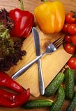 Utensils and vegetables Stock Image
