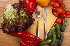 Utensils and vegetables Royalty Free Stock Image