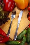 Utensils and vegetables Royalty Free Stock Photo