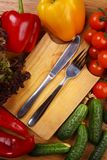 Utensils and vegetables Stock Images
