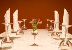 Utensils - wine-glasses and plates on a table Royalty Free Stock Photos