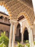 Uteplats de las Doncellas i kunglig slott av Seville Arkivfoton