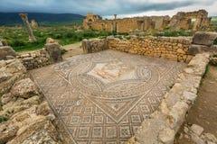 Utgrävningar i Archeologiquen de Volubilis, Marocko arkivbild