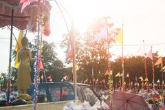 Tak Bat Devo and Chak Phra Festivals. UTHAI TANI , THAILAND - OCTOBER 25 , 2018 : The golden standing Buddha on car in Tak Bat Devo and Chak Phra Festivals on stock image