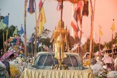 Tak Bat Devo and Chak Phra Festivals. UTHAI TANI , THAILAND - OCTOBER 25 , 2018 : The golden standing Buddha on car in Tak Bat Devo and Chak Phra Festivals on stock images