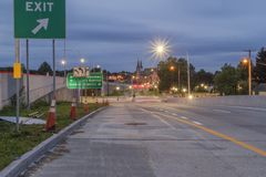 UTICA, NEW YORK - SEP 30, 2018: Night shot of Utica City Streets with sign and traffic light in the background. Long exposure blue hour evening cityscape stock photography