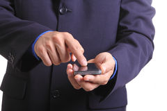 Utilice el teléfono elegante del tacto del finger Foto de archivo