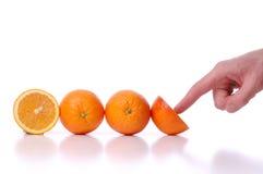 Utilice y las naranjas perfectamente frescas de los empujes foto de archivo libre de regalías