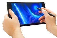 Utilisant le crayon lecteur sur l'écran tactile Photo libre de droits