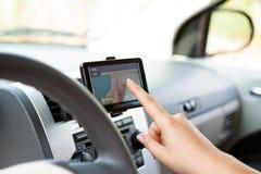 Utilisant le dispositif de navigation Photos libres de droits