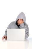 Utilisateur d'adolescent frustrant d'ordinateur Photographie stock libre de droits