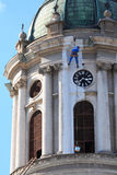 Utilitary alpinism. During the reconstruction of the Catholic Cathedral of Arad, Romania Stock Photography