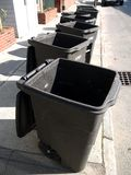Utilities: garbage bins on street Stock Photo