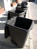 Utilities: garbage bins on street stock photo