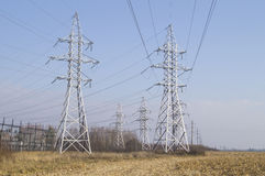 Utilities. A number of high-voltage power lines. Royalty Free Stock Photography