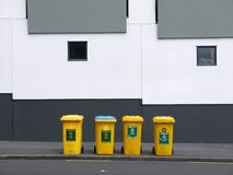 Utilities: yellow recycling bins Royalty Free Stock Image