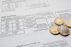 Utility bill. And coins for payment Stock Image