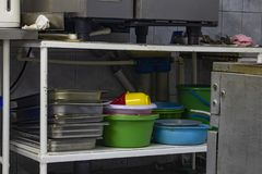 Utility dishes washed in the dishwasher area, in the kitchen of the restaurant royalty free stock photos