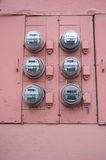 Utility meters. Collection of 6 utility meters on the exterior wall Stock Image