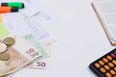 Utility or mortgage bills, calculator and Euro banknote and coin Stock Photography