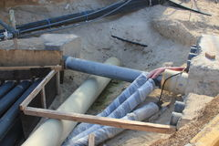Utility pipes being laid for a new building Stock Photos