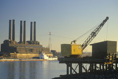A utility plant and grain barge on the Mississippi River in East St. Louis, Missouri Royalty Free Stock Photos