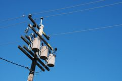 Utility pole. Electric utility pole, transformers and wires stock photos