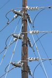 Utility pole. Showing different types of insulators Royalty Free Stock Image