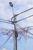 Utility pole. With bunch of electric wires and cables Royalty Free Stock Photo