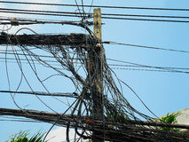 Utility pole supporting messy wires Stock Photos