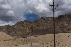 Utility poles in ladakh mountain landscape Royalty Free Stock Image